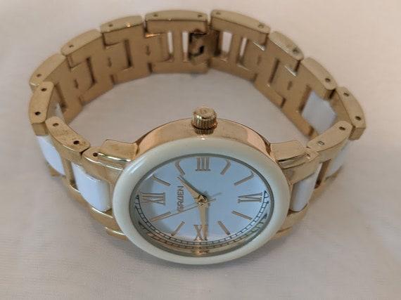 Women's Gruen Sports Watch. Gruen Gold and White Ceramic 100 Ft.Water Resistant Wrist Watch. Japan Movement Quartz Womens Gruen Casual Watch