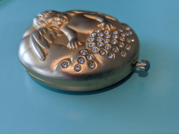 Vintage Estee Lauder June Angel Compact. Translucent Press Powder Compact. Rhinestone Jeweled Compact. Golden Cherub Estee Lauder Compact