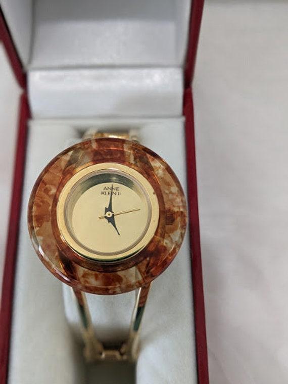 Anne Klein ll Ladies Watch. Gold and Tortoise Lucite Women's Watch. Gold and Tortoise Anne Klein ll Cuff Bracelet Watch