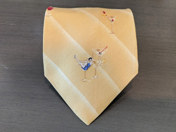 Vintage Tommy Bahama Pin Up Girl Neck Tie.  Tommy Bahama Yellow Stripe Tie. Pin Up Girls and Cocktail Drinks Theme Neck Tie.