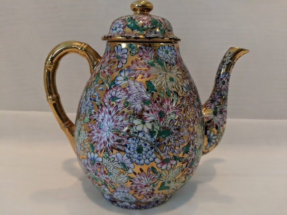 Antique Porcelain Japanese Coffee/Tea Pot. Polycrome Enamel Leaf & Floral Design With Gold Accent Coffee Pot. Decorated in Hong Kong