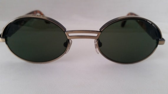 Vintage Bad Boy Small Oval Sunnies. Bad Boy Green Lenses Oval Shades. Cute, Oval Bad Boy Sunglasses Cool and Funky. Antique Gold Color frame