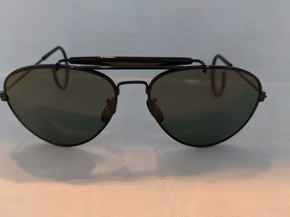 Black / Vintage Small Aviator Sunglasses With Cable Ear Pieces. Black Aviator Sunnies With Impact Resistant Glass Lenses. Cool Aviators