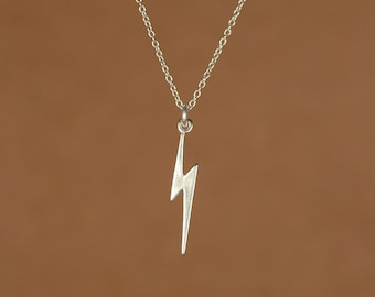 Lightening bolt necklace - gold lightening bolt - thunder - storm - a 22k gold overlay lightening bolt on a 14k gold vermeil chain