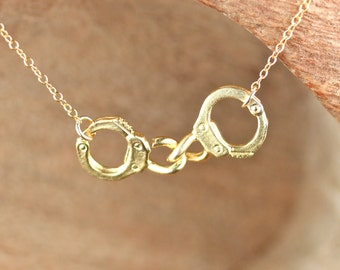 Handcuff necklace - partners in crime - a pair of gold handcuffs on a 14k gold vermeil chain