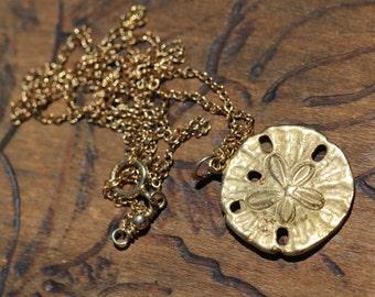 Sand dollar necklace - sanddollar - gold sand dollar necklace - a dainty gold sand dollar hanging from a 14k gold vermeil chain