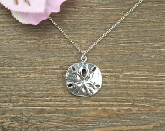 Silver sand dollar necklace - delicate necklace - a dainty sterling silver sand dollar hanging from a sterling silver chain