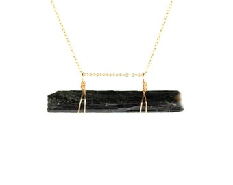 Crystal necklace - aegirine necklace - black crystal - wand - bar necklace - a black aegirine hangs horizontally on a 14k gold vermeil chain