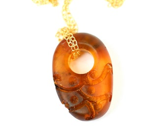 Baltic amber necklace - raw amber necklace - hand carved amber - a piece of carved amber hanging from a 14k gold vermeil chain