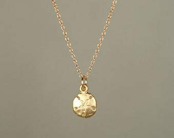 Gold sand dollar necklace - delicate necklace - a tiny 14k gold vermeil sand dollar hanging from a 14k gold filled chain