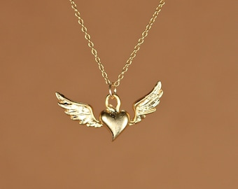 Flying heart necklace, silver heart pendant with wings, wing necklace, a 14k gold vermeil heart and wings on a 14k gold filled chain