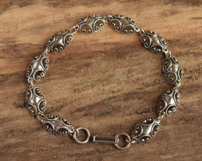 Beau Sterling Silver Bracelet