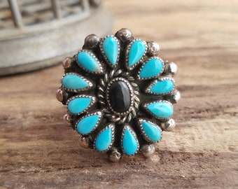 Turquoise cluster ring  size 9 1/2 onyx center