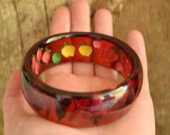 Prystal Bakelite - Reverse Carved and Painted Fruit and Vegetables Red Bakelite Bangle