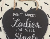 Don't worry ladies im still single chalkboard sign