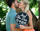Round save the date chalkboard sign.