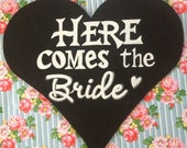 Heart shaped Here comes the bride chalkboard sign.