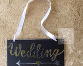 Gold glitter wedding chalkboard sign.
