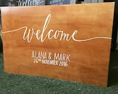 Timber welcome sign