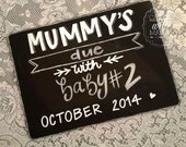 Mummys due with baby chalkboard sign.