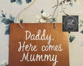 Daddy here comes mummy timber wedding sign.