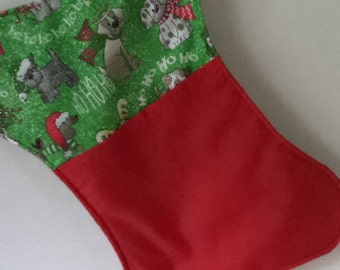 Dog bone shaped stocking in a dogie print and a solid fabric