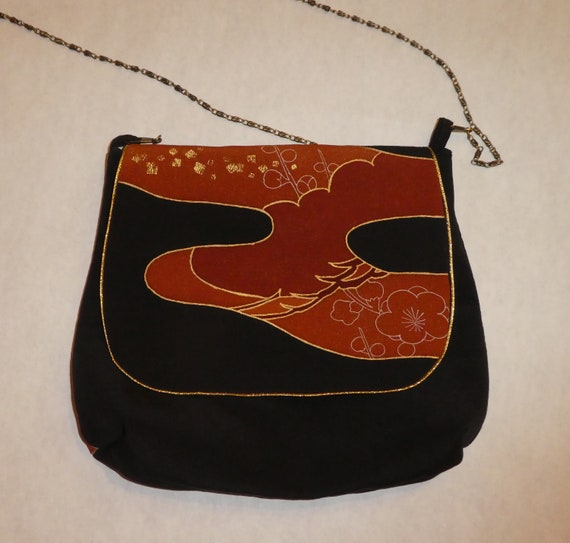 Silk messenger bag made from vintage Japanese kimono.  Black with gold, brown Asian motifs. Fully lined B84
