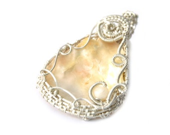 Eco jewellery, wire wrapped shell and pearl pendant