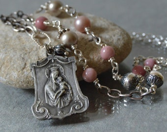 A scapular medal necklace featuring a vintage medal of the Sacred Heart of Jesus and the Immaculate Heart of Mary