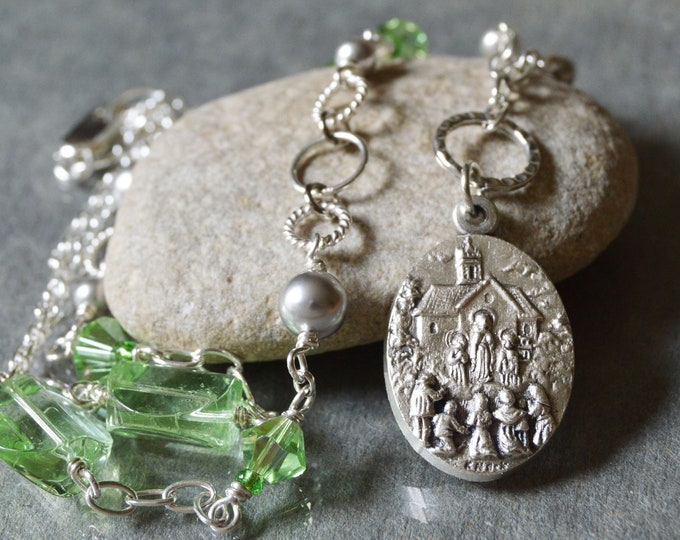 Our Lady of Knock necklace in peridot green and dove grey
