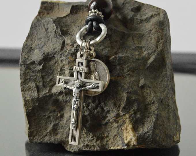 Religious Catholic Jewelry for Men in a leather necklace featuring a Crucifix and vintage Saint Ann relic medal
