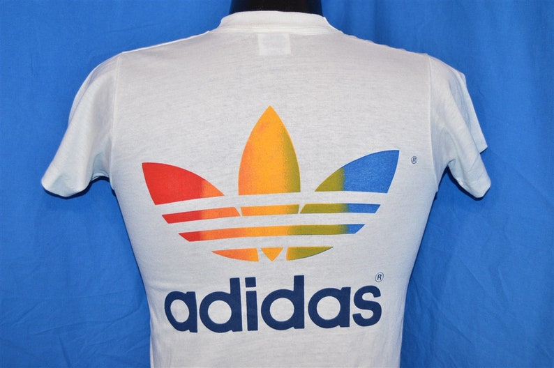 eb0ec82511ad1 80s Adidas Rainbow Trikot Trefoil Bob Wieland Walk for Hunger White Vintage  t-shirt Youth Large