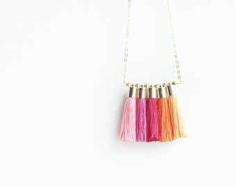 statement necklace tassel . long mini tassel necklace . colour block jewellery . pink red sunset yellow orange fuchsia . statement jewellery