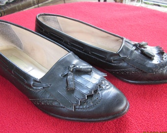 95aa440d7aa Black Aigner Kiltie Tassell Loafers-- Women s