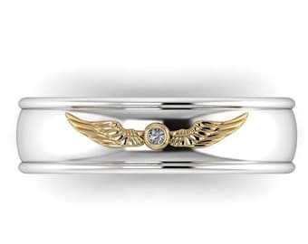 WINGED: Wizard inspired wedding band with golden winged ball and Canadian Diamond accent in your choice of two tone metals!