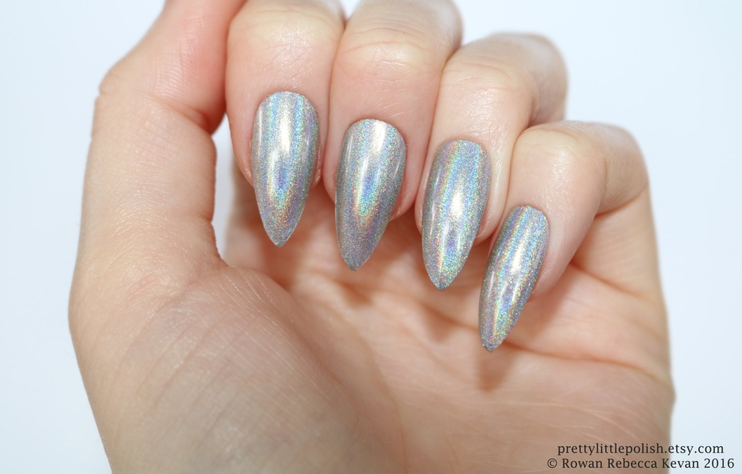 To acquire Silver and black pointy nails pictures trends