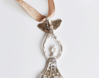 Silver Pendant Woman with Bird on a Starry Blue Night