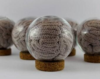 Grey matter in a glass ball