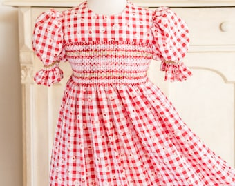 259 Hand-smocked red and white embossed Gingham dress, age 5 to 6, with smocked puff sleeves and pin-tuck hem