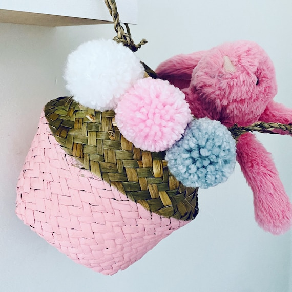 Pink Mini Seagrass Basket with pink, grey and white pom poms.