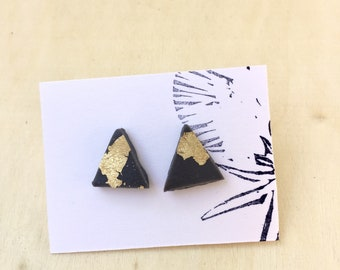 Gray and gold triangle studs