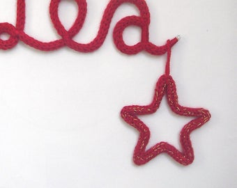 Star, moon, complementary heart in knitting
