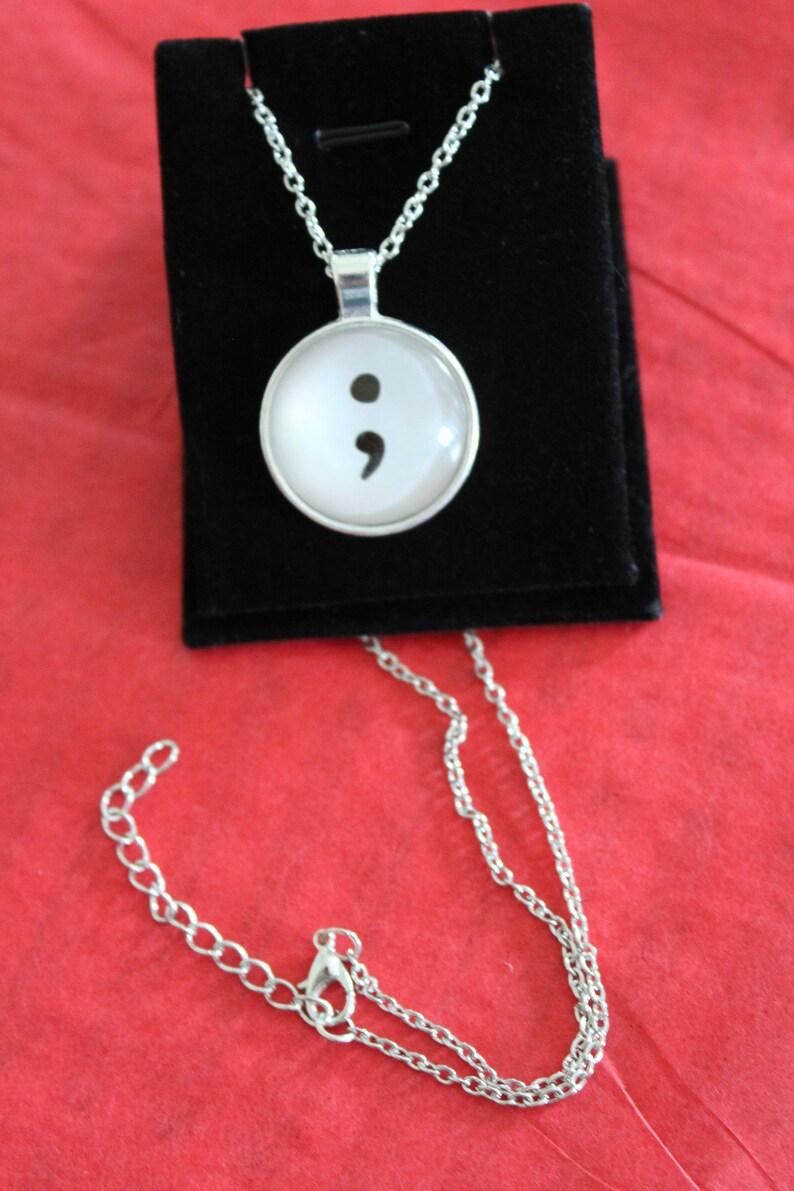Semi colon pendant necklace