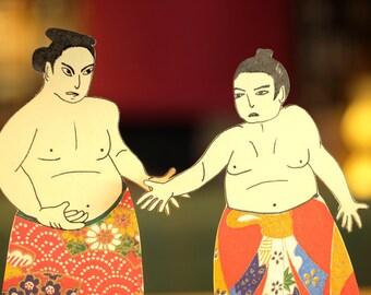 Sumo wrestlers, paper cuts