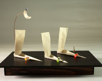 Origami paper light with bamboo boats