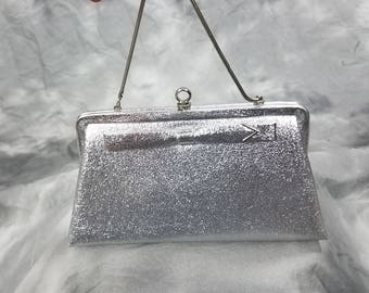 1950s 60s metallic silver clutch hand bag with bow