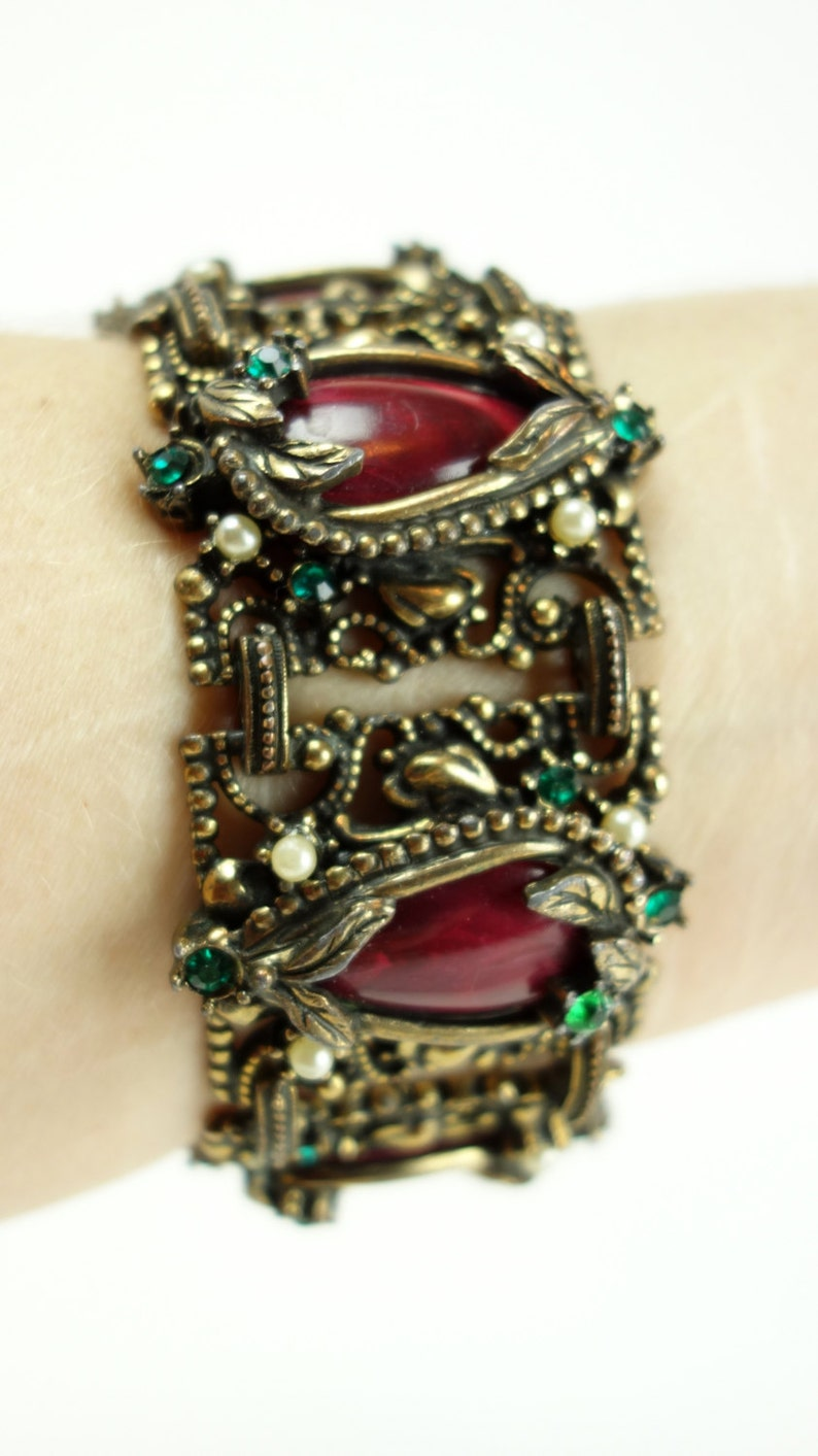 Gold tone bracelet white pearl and red tear drop center lucite wide cocktail bracelet green rhinestone