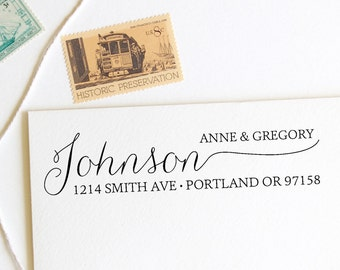 Return address stamp with hand drawn style calligraphy last name, first and last names, self inking