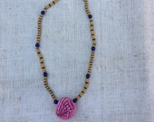 Necklace with shibori silk ball and small glass beads.