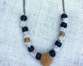 Golden shibori silk and green glass beads necklace.